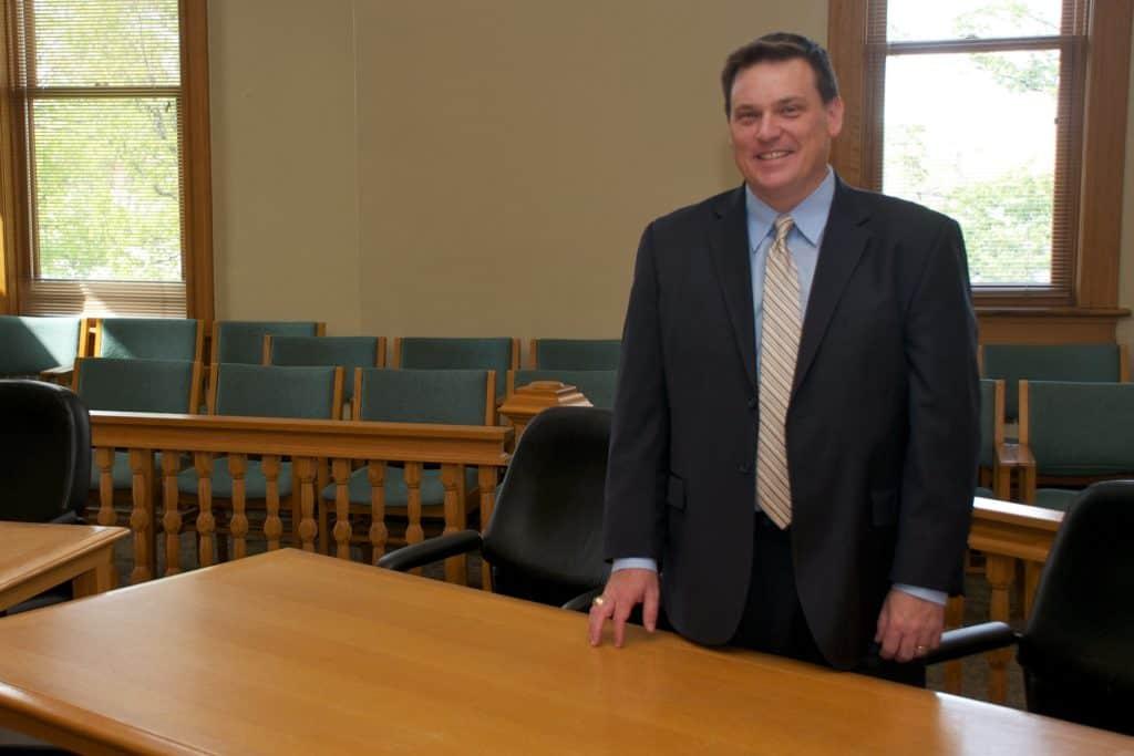 Matt Benedict standing in courtroom dressed for court.