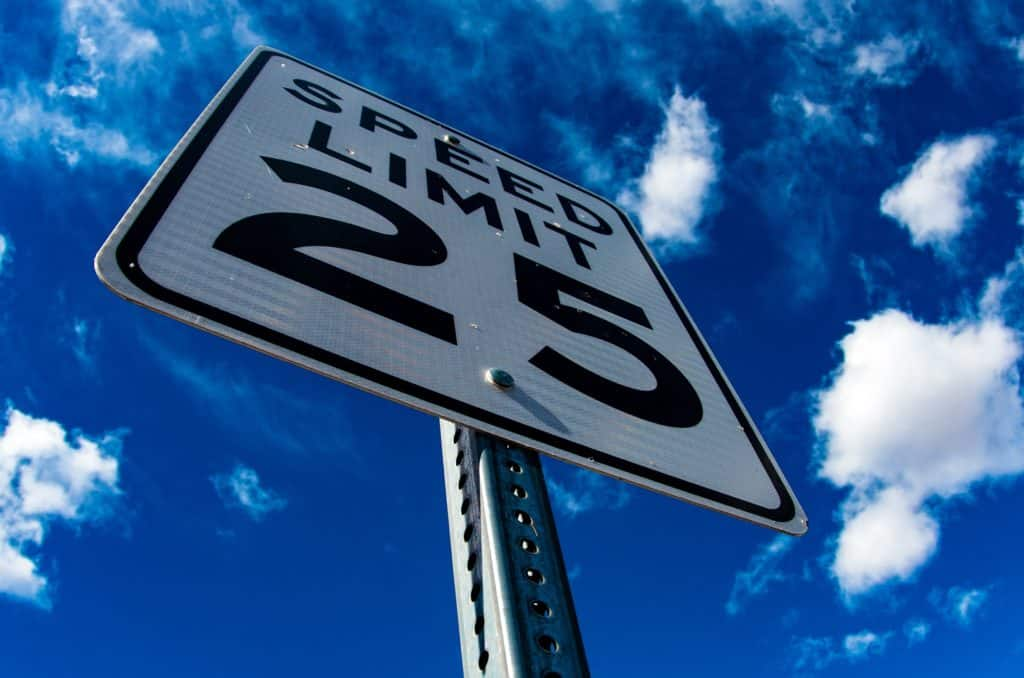 Speed limit sign. Speeding is large reason for traffic tickets.