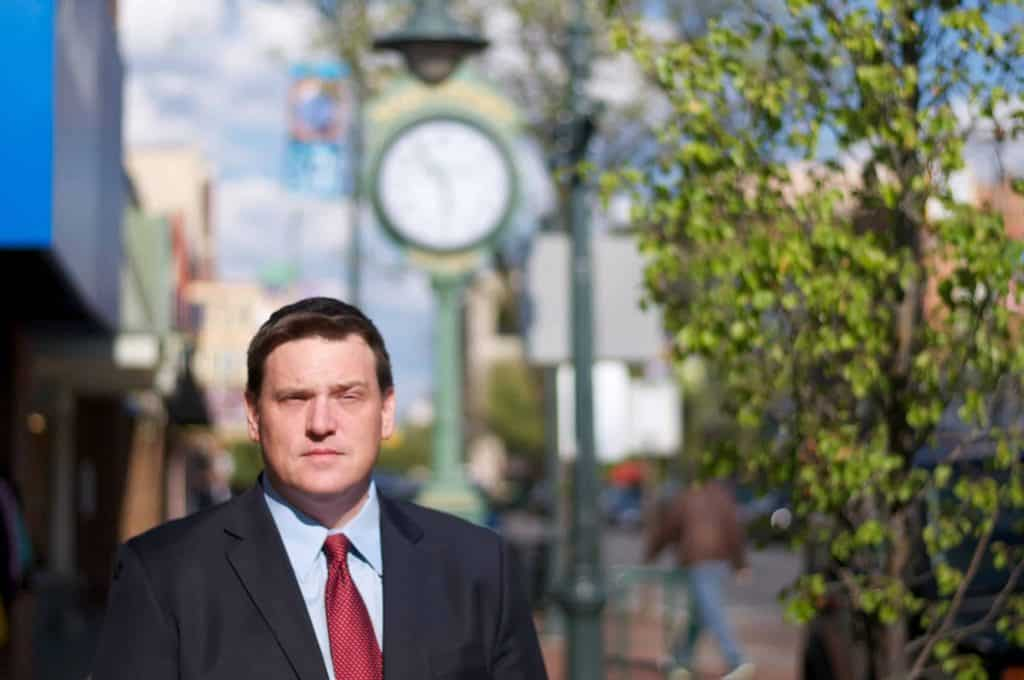 Traverse City Attorney Matthew Benedict walking on Front Street